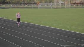 The girl runs in the stadium. stock video footage