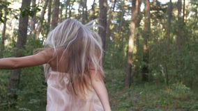 Girl runs through a thicket stock video
