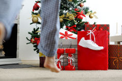 Girl runs to the Christmas tree for gifts. Royalty Free Stock Photo