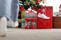 Girl runs to the Christmas tree for gifts. Stock Photo