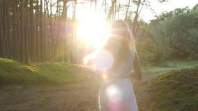 The girl runs to meet the sun stock footage