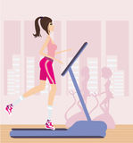 Girl runs on a treadmill Stock Photo