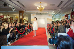 The girl on the runway and spectators Stock Photos