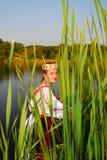 Girl in rushy lake Royalty Free Stock Image