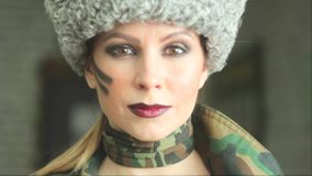 Girl in Russian army uniform stock footage