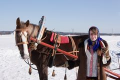 Girl in russian  clothes and horse Royalty Free Stock Photos