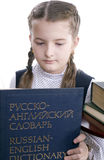 Girl and  Russian-English dictionary Royalty Free Stock Photo
