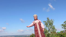 Girl in Russian folk costume welcomes stock video footage