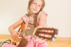 Girl with russian seven-string acoustic guitar Stock Image