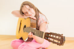 Girl with russian seven-string acoustic guitar Stock Photo
