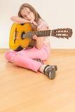Girl with russian seven-string acoustic guitar Royalty Free Stock Photos
