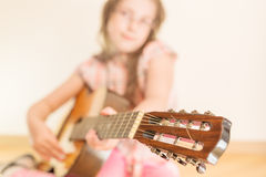 Girl with russian seven-string acoustic guitar Stock Images