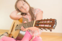 Girl with russian seven-string acoustic guitar Royalty Free Stock Photo