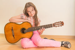 Girl with russian seven-string acoustic guitar Royalty Free Stock Photography