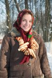 Girl in russian traditional clothes with cracknel Stock Images