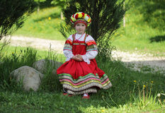 Girl in russian traditional folk clothes. Happy girl in russian traditional folk clothes Stock Photos