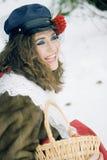 Girl in russian traditonal clothing for maslenitsa. Maslenitsa,a russian spring celebration holiday, a woman wearing traditional russian clothing royalty free stock photo