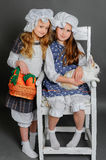 Girl in a rustic style with the Easter bunny. Laughing girl in a rustic style with the Easter bunny, carrot and basket Stock Images