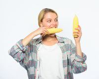 Girl rustic style hold ripe corn. Vegetarian product. Raw food diet concept. Girl practice eating only or mostly food. Uncooked and unprocessed. Woman farmer stock image