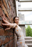 Girl in rusty building Royalty Free Stock Image