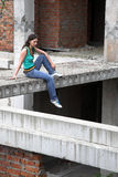 Girl in rusty building Royalty Free Stock Images