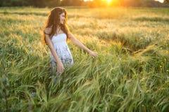 Girl in rye field Stock Photos