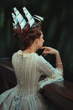 The girl's back. She has on the head ship. royalty free stock image