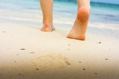 Girl`s barefoot feet walking on white sandy caribbean beach. Dominican Republic Stock Photography