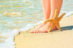 Girl's barefoot legs Royalty Free Stock Image