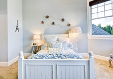 Girl's Bedroom in New home. Beautiful furnished bedroom for young girl royalty free stock images