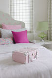 Girl's bedroom with pink box on green bed Royalty Free Stock Photo