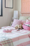 Girl's bedroom in pink color with pillows and doll Royalty Free Stock Images