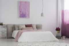 Girl`s bedroom with pink painting