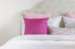 Girl's bedroom with pink pillow on green bed Stock Photography