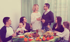 Girl`s birthday at home. Happy family sitting at holiday table, toasting and smiling royalty free stock photos