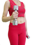 Girl's body with dumbbells. Isolated stock photography