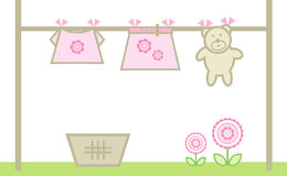 Girl's clothing on a washing line. Illustration of pink (girl) clothing and teddy bear hanging on a washing line Stock Images