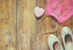 Girl's diamond tiara with pink chiffon vail next to ballet shoes Stock Photos