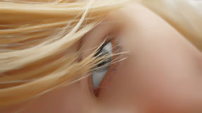 Girl's eye. Beautiful young girl's eye and soft textured skin stock images