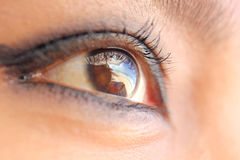 Girl`s eye. Photo image  with  girl`s eye and reflected  of the sea Stock Images