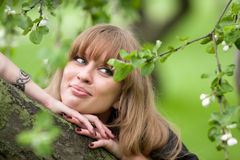 Girl's face and apple-tree flowers Stock Images