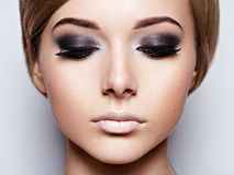 The girl`s face closeup with long black lashes. Royalty Free Stock Image