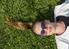 Girl`s face on the lawn stock images