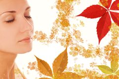 Girl's face and leaves. Beautiful girl's face and colorful autumn leaves around her Royalty Free Stock Images