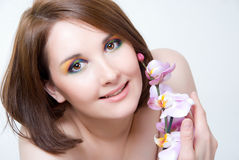 Girl's face and orchid Stock Photography