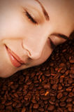 Girl S Face Over Coffee Beans Stock Photography