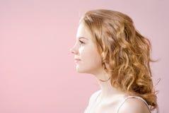 The girl's face in profile stock photos