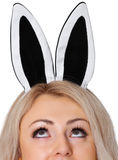 Girl's face with the rabbit ears on white Royalty Free Stock Images