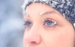 Girl's face in snow Royalty Free Stock Images