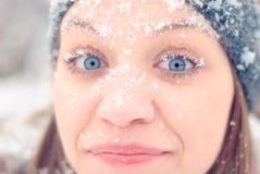 Girl's face in snow Stock Photo